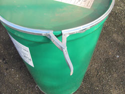 The Barrel Smoker Lid Is Secured By A Metal Banding Clasp