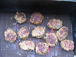 Lamb Kofte's cooking on a Teflon BBQ grill mat