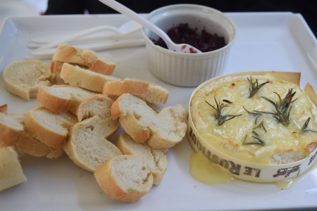 Baked Camembert With Cranberry Sauce And Sliced Baguette
