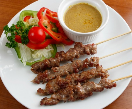Barbecue beef satay skewers with salad