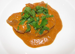 Indian Butter Chicken Garnished With Chopped Coriander (Cilantro)
