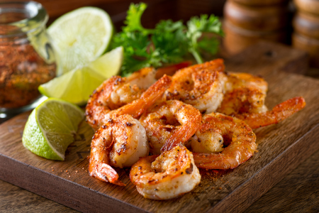 Cajun barbecue shrimps garnished with fresh lime