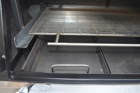 The charcoal trays allow direct heat and also act as the baffle plates when smoking