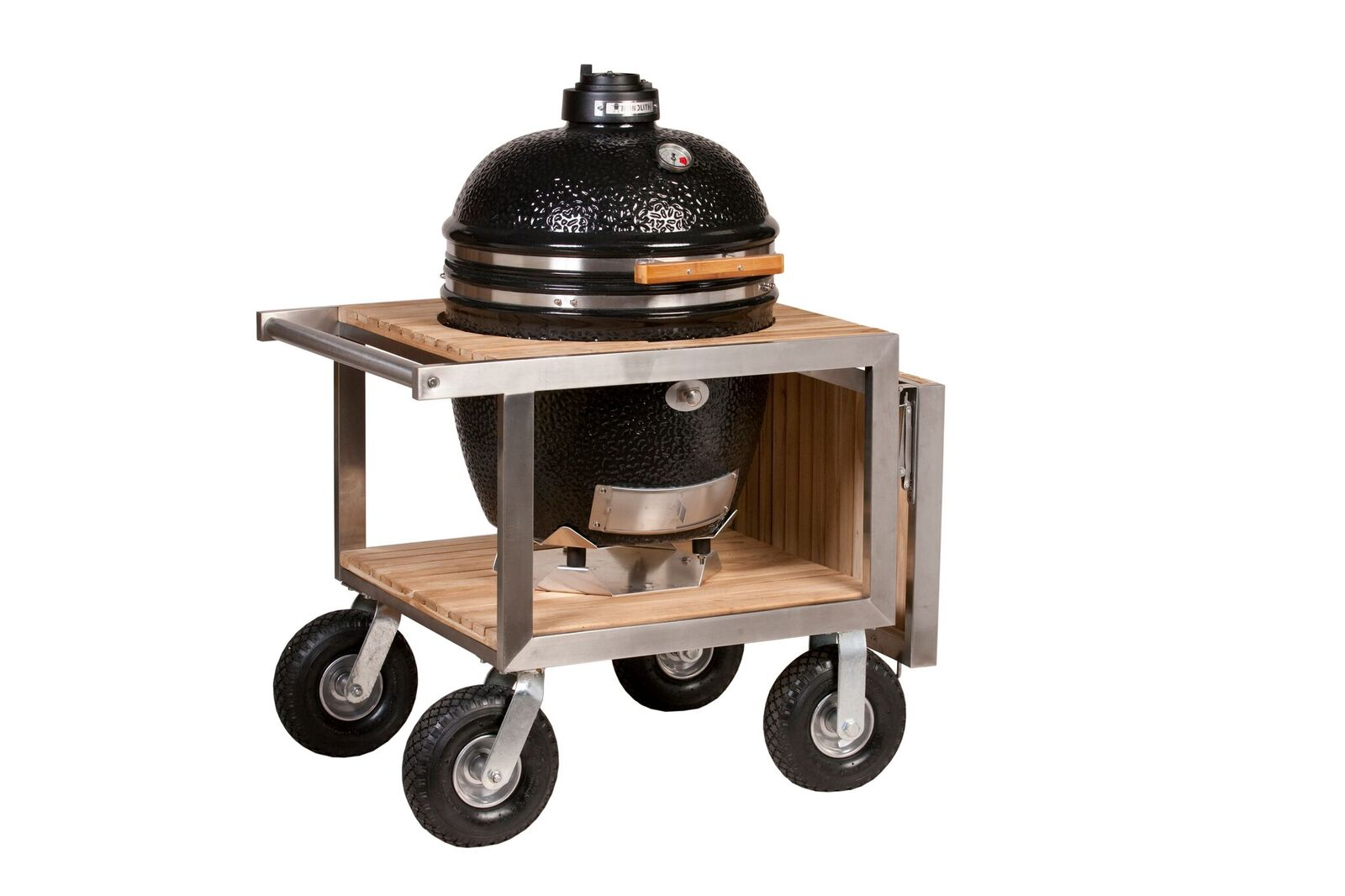 The Monolith ceramic grill in the stainless steel framed buggy with folding side shelf