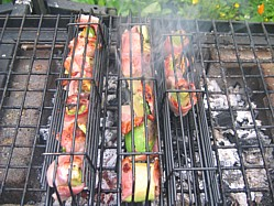 Grilling Avocado and bacon parcels in a basket