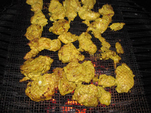 Grilling the marinated chicken