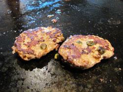 Grilled hamburgers on the plancha
