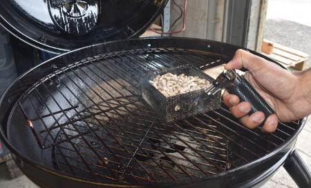 Lighting the Grillson cold smoke generator with the flame torch which is included in the kit