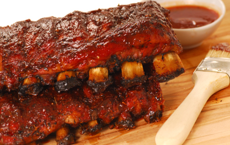 Homemade BBQ sauce mopped over ribs