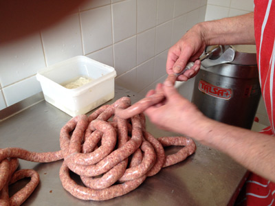 Homemade venison sausage being stuffed into hog casings