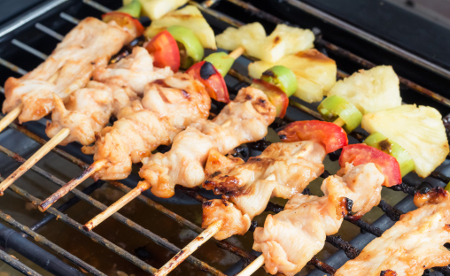 Indian BBQ chicken kebabs on the grill