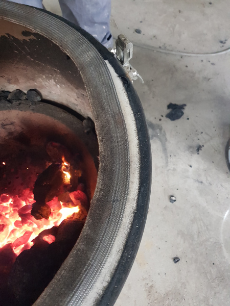 The problem with the Kamado Joe gasket is that it comes unstuck at higher temperatures