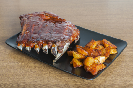 Oven barbecue ribs with fried potatoes