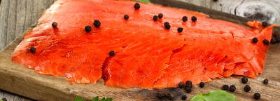 Cold smoked salmon and black peppercorns