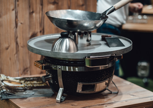 Monolith Icon With Fire Plate & Wok Stand Differentiates It From Big Green Egg MiniMax.