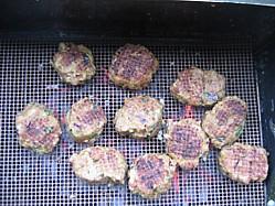Lamb Kofte's cooking on a Teflon BBQ grill mat