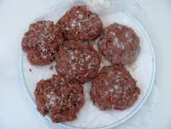 seasoned venison burgers ready for the grill