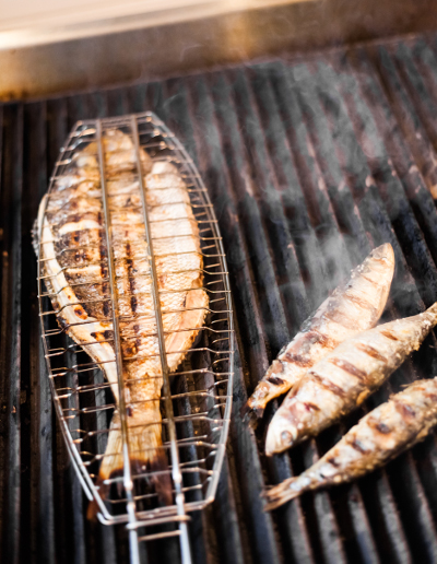 Barbecue sea bass on the frill in a fish basket