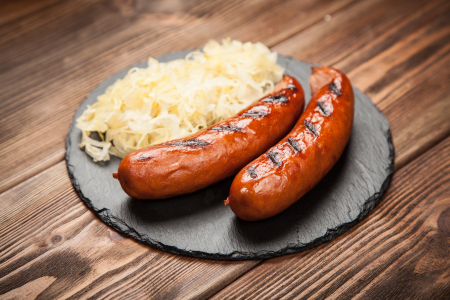 Cured bratwurst sausage served with sauerkraut