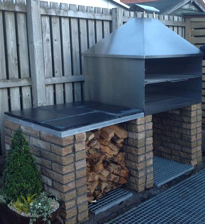 Here's one of our stainless steel charcoal grills with hood and flue