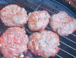 Chorizo grilled burgers cooking.