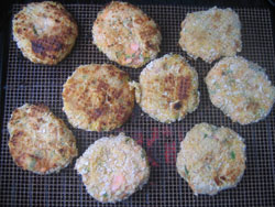 Trout fish cakes cooking on the grill
