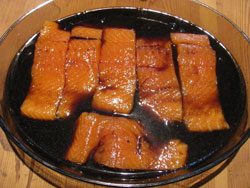 Grilled salmon marinading in teriyaki