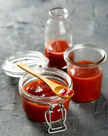Homemade tomato ketchup being bottled up