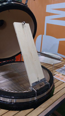 Fix your salmon to the underside of this kamado cooking plank