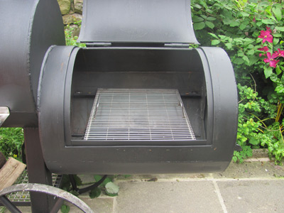 The offset firebox can be used as a grill too