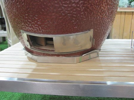 Monolith stainless steel framed teakwood table with stainless steel plinth